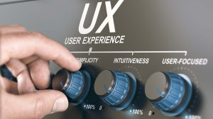 Man turning a knob to adjust UX parameters. User experience concept